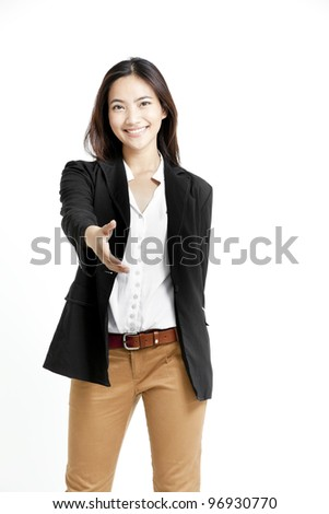 Portrait of a beautiful businesswoman offering handshake over white background.