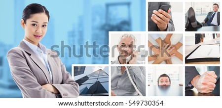 Portrait of a beautiful businesswoman posing with the arms crossed against view of a business desk