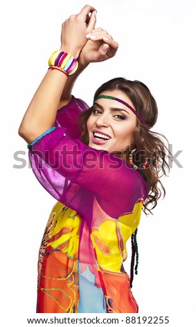 Portrait of a beautiful casual woman in colorful dress - stock photo