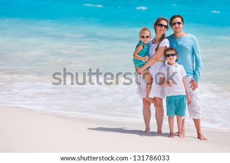 Portrait of a beautiful Caucasian family at tropical beach