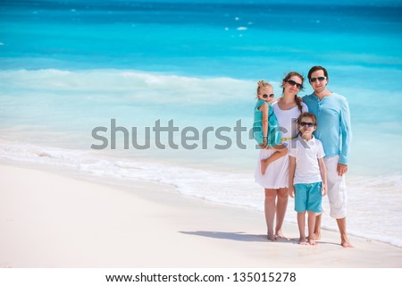 Portrait of a beautiful Caucasian family at tropical beach - stock photo