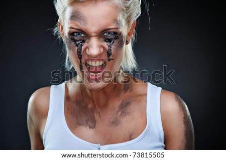 Portrait of a beautiful caucasian punk girl with dirt on her face. Shouting, studio shot - stock photo
