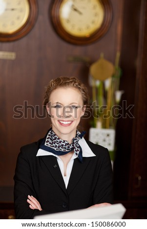 Portrait of a beautiful Caucasian woman working as receptionist ready to welcome tourists - stock photo
