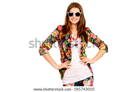 Portrait of a beautiful cheerful woman in summer clothes and sunglasses smiling at the camera. Isolated over white. - stock photo
