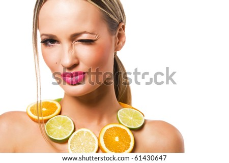 Portrait of a beautiful cheerful woman with perfect healthy skin and fruit necklace