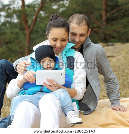 Portrait of a beautiful cheerful young family