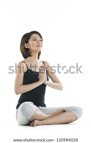 Portrait of a beautiful Chinese woman in Lotus yoga position.