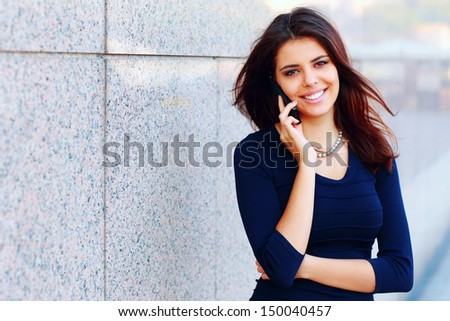 Portrait of a beautiful confident businesswoman talking on phone