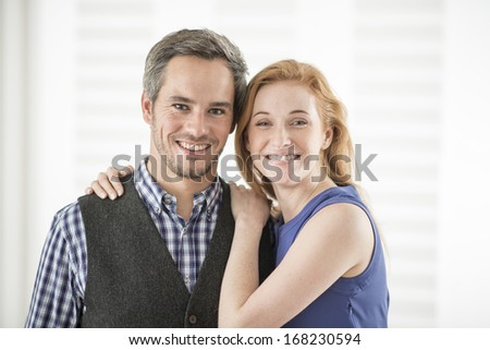 portrait of a beautiful couple looking at camera