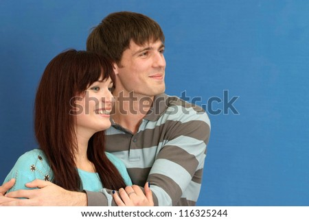 portrait of a beautiful couple on a blue background - stock photo