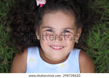 Portrait of a beautiful curly little girl.