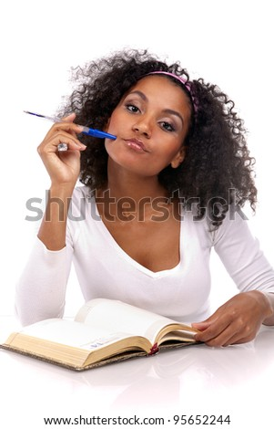 portrait of a beautiful dark-skinned woman with a note-book in a white dress in the studio - stock photo
