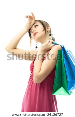 portrait of a beautiful elegant young woman tired of shopping