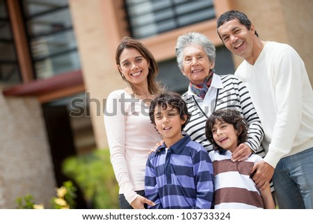 Portrait of a beautiful family smiling and looking happy - stock photo