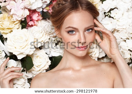 Portrait of a beautiful fashion bride, sweet and sensual.  Wedding make up and hair. Flowers background. Art modern style. Blue eyes - stock photo