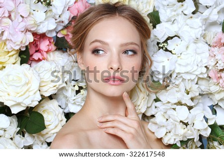 Portrait of a beautiful fashion bride, sweet and sensual. Wedding make up and hair. Flowers background. Art modern style. Bl - stock photo