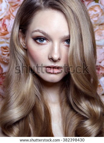 Portrait of a beautiful fashion bride, sweet and sexy. Wedding make up and hair. Flowers background. Art modern style. Blue eyes. - stock photo