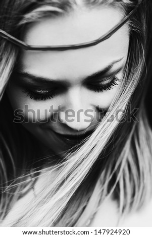portrait of a beautiful fashion girl close-up black and white - stock photo