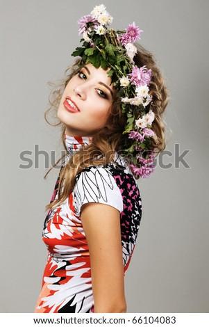 Portrait of a beautiful fashion model in flower crown - stock photo