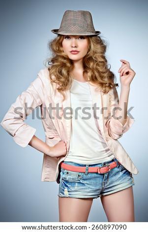 Portrait of a beautiful fashion model. Studio shot. - stock photo