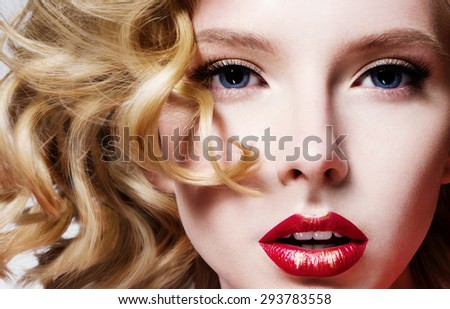 Portrait of a beautiful fashion model, with red lips and curly blond hair - stock photo