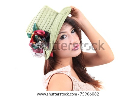 Portrait of a beautiful fashion woman posing with a hat - stock photo