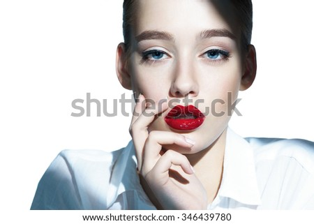 Portrait of a beautiful fashion woman, sweet and sensual with red lips / close-up of an attractive girl of the European appearance in a white shirt - isolated on white background - stock photo