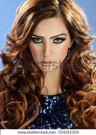 Portrait of a beautiful female fashion model in makeup  - stock photo
