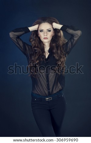 Portrait of a beautiful female fashion model with curly hair - stock photo