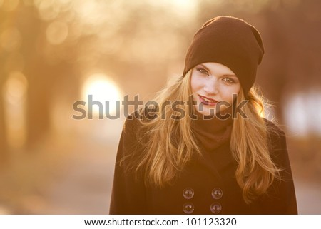Portrait of a beautiful female model in autmn clothes outdoor.sensetive look.close up