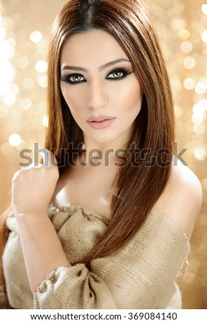 Portrait of a beautiful female model in makeup  - stock photo