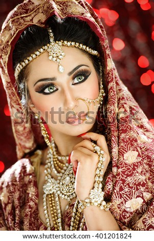 Portrait of a beautiful female model in Traditional ethnic outfits and heavy makeup