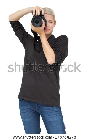 Portrait of a beautiful female photographer over white background