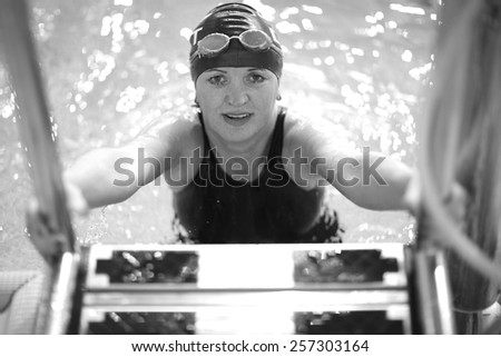 Portrait of a beautiful female swimmer in the pool - stock photo