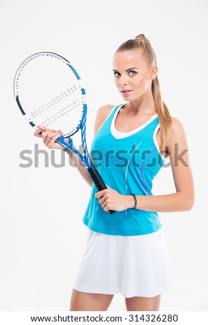 Portrait of a beautiful female tennis player standing isolated on a white background