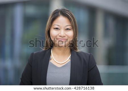Portrait of a beautiful Filipino businesswoman in smart business suit.
