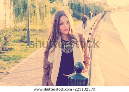 Portrait of a beautiful girl against water, film color, instagram style.  Sad unhappy girl in the autumn , stress, depression - stock photo