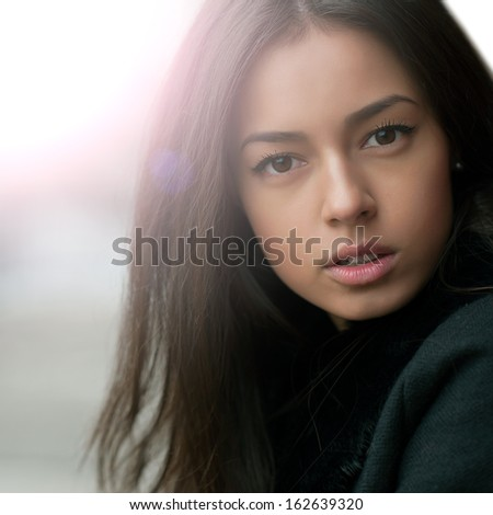 Portrait of a beautiful girl close up - stock photo