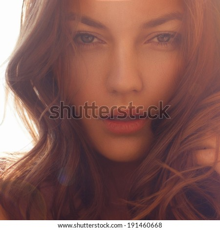Portrait of a beautiful girl face close-up, solar tinting - stock photo