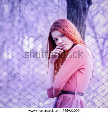 portrait of a beautiful girl hipster. Photo in violet tones  - stock photo