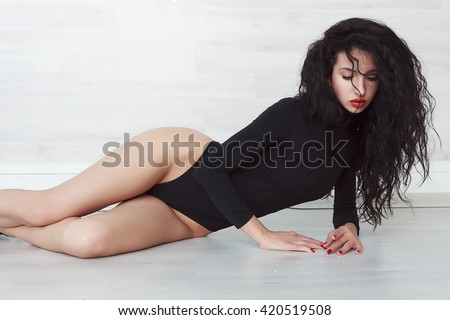 portrait of a beautiful girl in a black bodysuit - stock photo