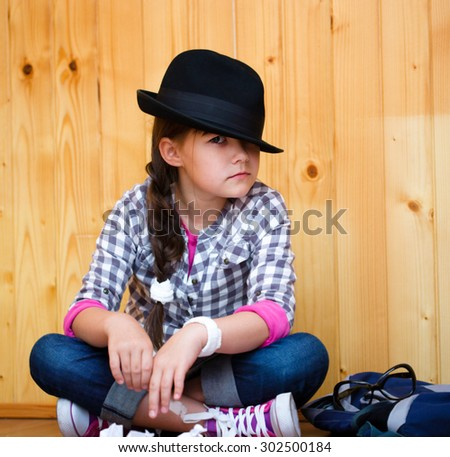 Portrait of a beautiful girl in a black hat - stock photo