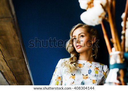 portrait of a beautiful girl in a cafe  - stock photo