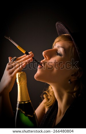portrait of a beautiful girl in a dark room smoking a cigarette with a mouthpiece