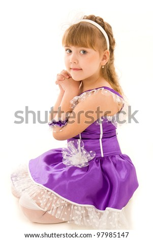 Portrait of a beautiful girl in a dress isolated on white