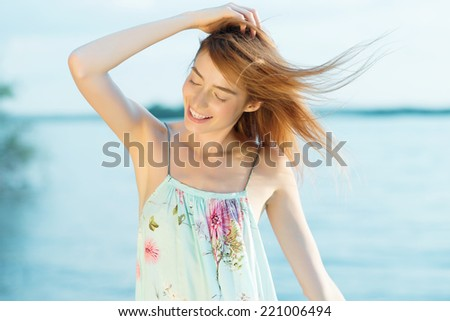 Portrait of a beautiful girl in a dress on the beach, lifestyle - stock photo