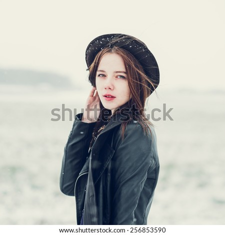 portrait of a beautiful girl in a hat hipster