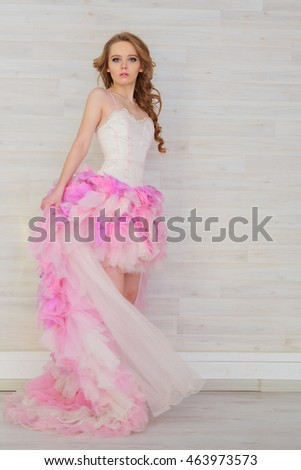 Portrait of a beautiful girl in a pink dress skirt
