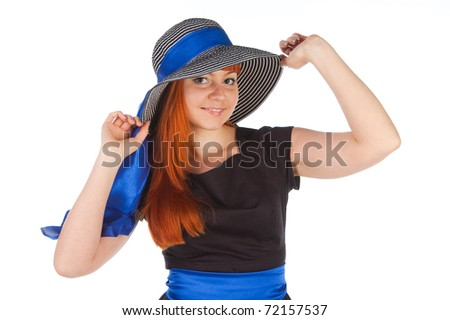 Portrait of a beautiful girl in a summer hat. Isolated over white background.