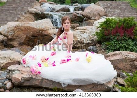 Portrait of a beautiful girl in a white dress on the nature - stock photo